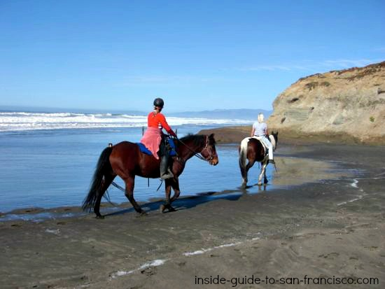 riding horses on the beach, san francisco