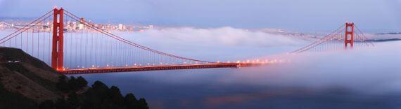 Aerial view of fog coming through the Golden Gate Bridge