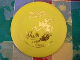 disc golf, yellow disc top view