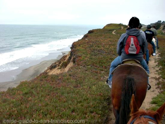 riding horses on the beach, san francisco