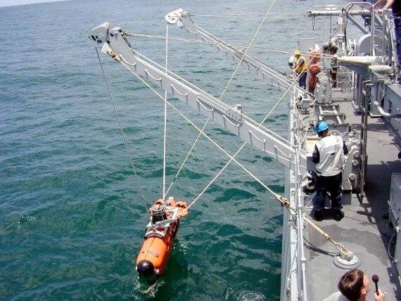 USS Champion launching minesweeping vehicle