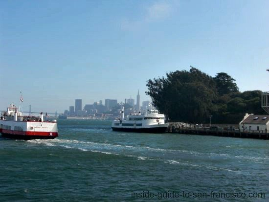 red and white ferry passing alcatraz