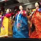 Chinatown dolls for sale in window thumbnail