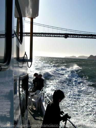 san francisco bay cruises, fishing boat near the bridge