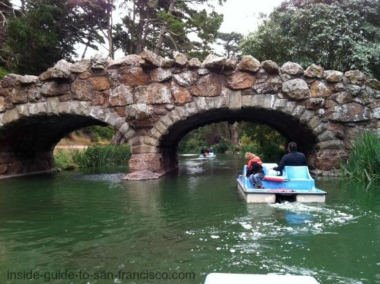 stow lake, paddle boats, under bridge