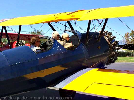 vintage biplane ready for takeoff, airplane rides in sonoma