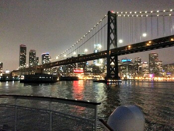 SF and Bay Bridge at night on dinner cruise