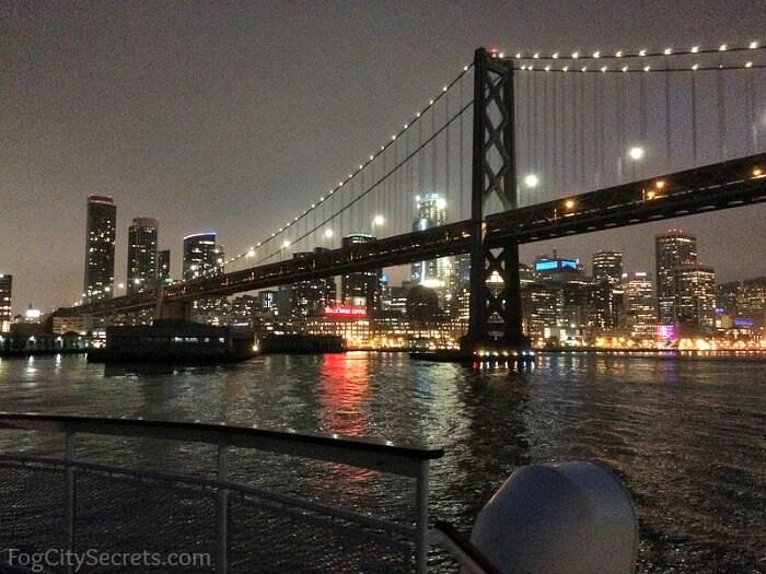 SF dinner cruise, city and bridge lights.
