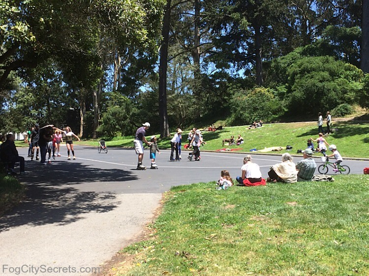 Adults and children rollerskating in Golden Gate Park
