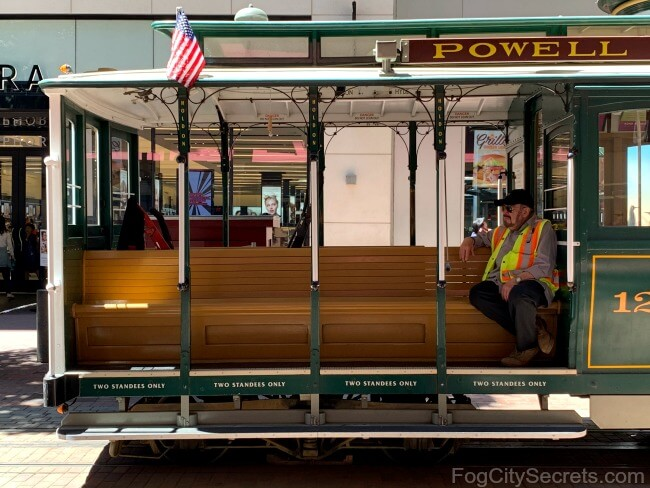 Grip man waiting on Powell cable car