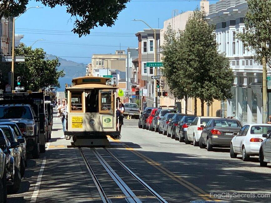Cable car going through North Beach neighborhood