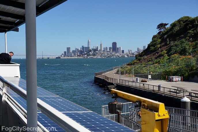 Ferry docking at Alcatraz, San Francisco skyline