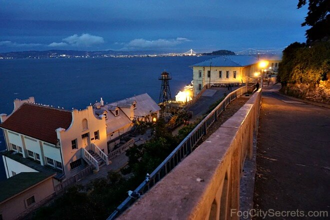 Night tour on Alcatraz, view of old fort and bay lights.