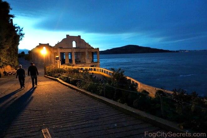 Alcatraz after dark, couple on walkway