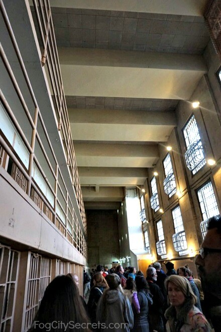 Crowds in Alcatraz cell block corridor, night tour