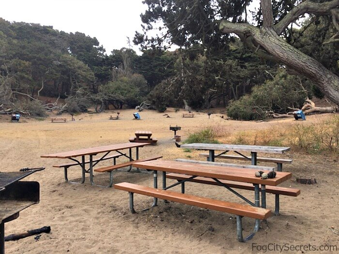 Picnic tables and BBQ grills at Baker Beach