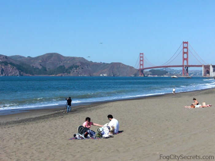 Baker Beach sunbathing, Golden Gate in background