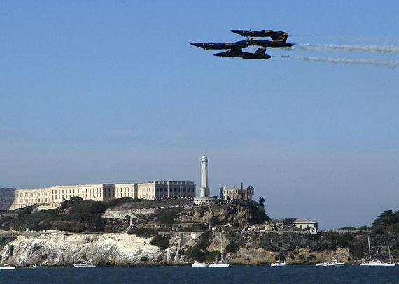 Tight formation of four Blue Angels flying past Alcatraz
