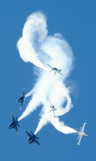 Blue Angels doing a dive in formation with smoke