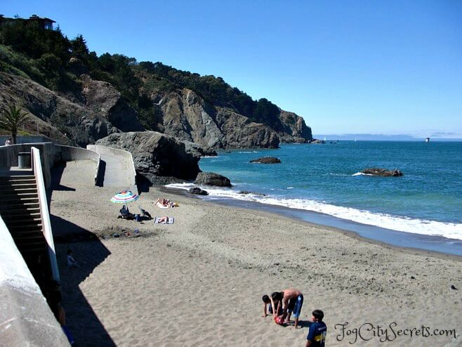 China Beach in San Francisco, kids playing on a sunny day