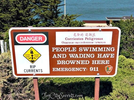 Warning sign for rip currents, China Beach, San Francisco