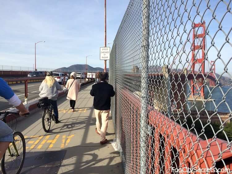 Entrance to the east sidewalk on the Golden Gate Bridge. Walkers and cyclists.
