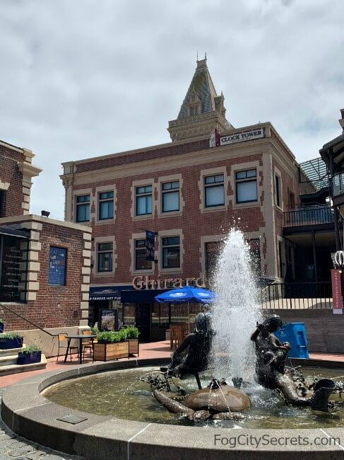 Clock Tower Building at Ghirardelli Square and Mermaid Fountain