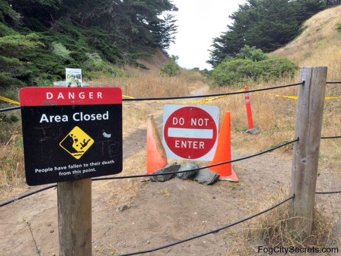 Entry to dangerous path at Lands End, with warning sign