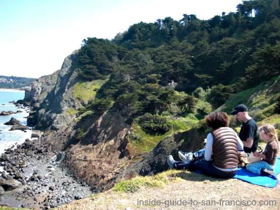 Family having a picnic at Lands End Point