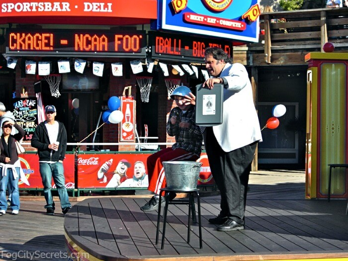 Magician performs on stage at Pier 39