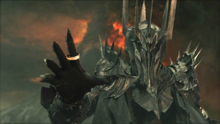 Sauron reaching, with the Ring on his finger.