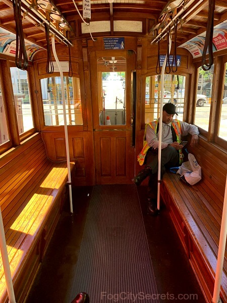 Interior of cable car on California line, grip man waiting