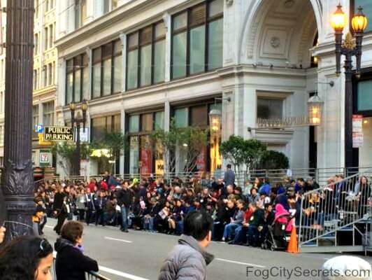 Visitors stands on Sutter Street, Chinese New Year Parade, San Francisco