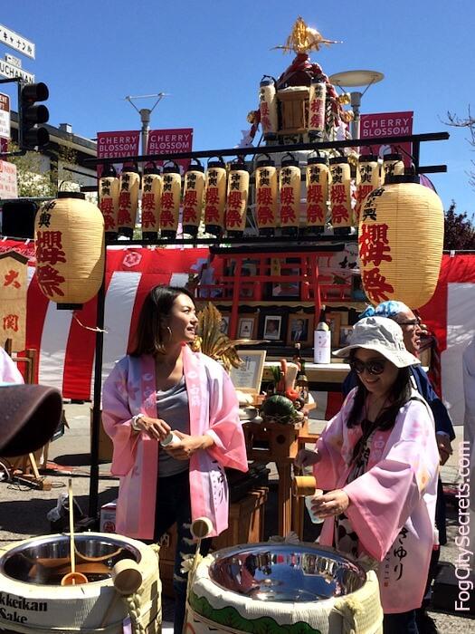 Ladies in pink kimonos handing out free sake at the Taru Mikoshi Shrine, San Francisco Cherry Blossom Festival 2018