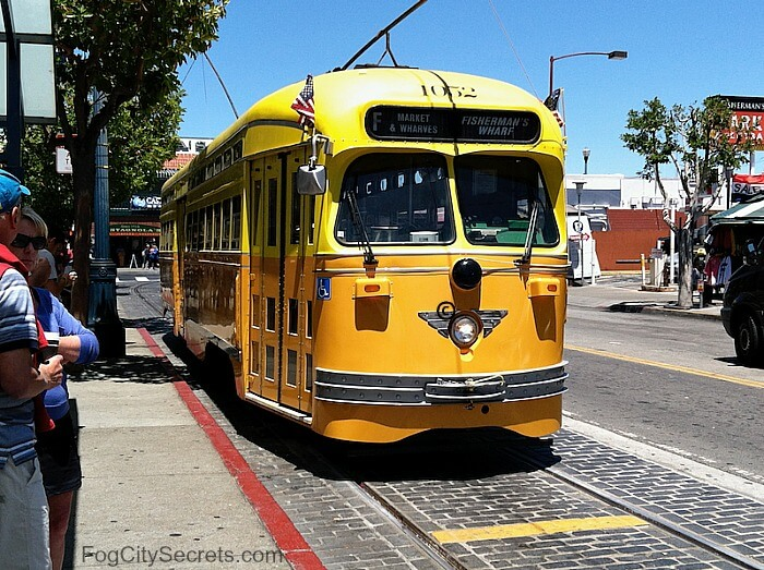 Yellow and orange F-Line trolley at Fisherman's Wharf