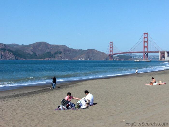 Baker Beach sunbathing, Golden Gate in background