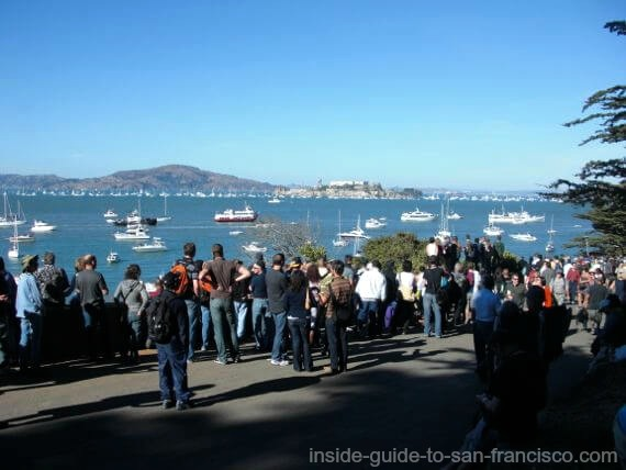 People standing at best view spot for Blue Angels at SF airshow.