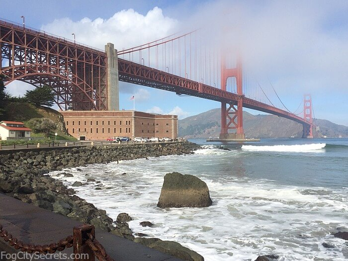 Fort Point sitting under the Golden Gate Bridge, with wisps of fog.