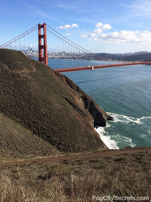 View of one tower of the Golden Gate Bridge, with San Francisco beyond it, from the Marin Headlands.