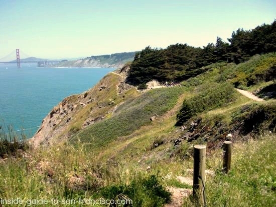 Lands End Coastal Trail winds along cliff edge, bridge view