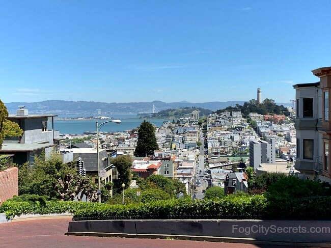 Top of Lombard Street, view of Coit Tower and SF bay.