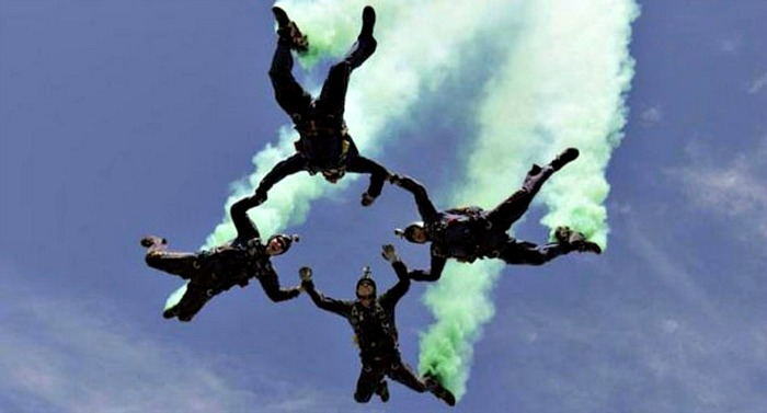 Navy Leap Frogs parachute team, four men jumping