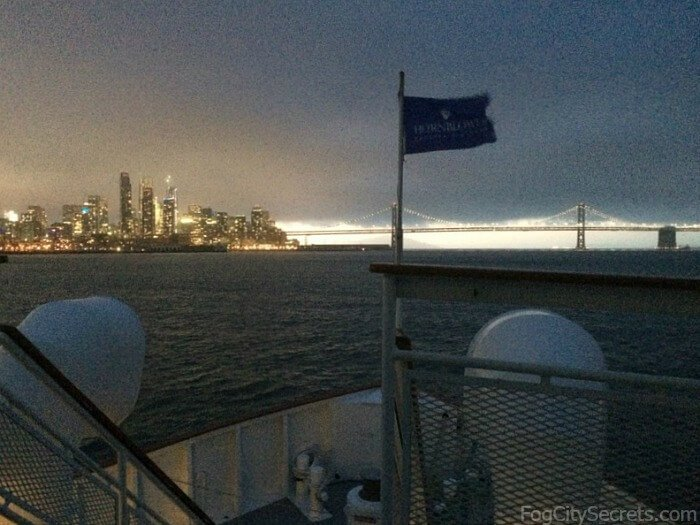 Night view of city skyline and Bay Bridge on San Francisco dinner cruise