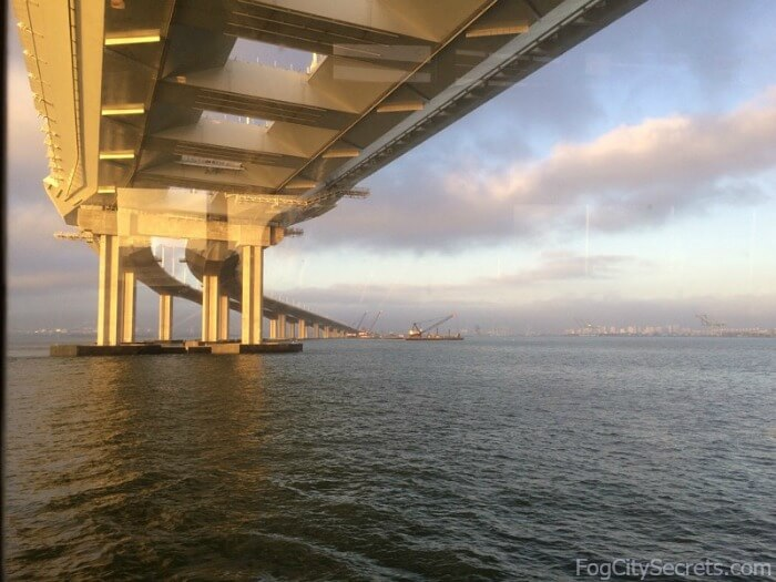 Sun setting while sailing under eastern span of SF Bay Bridge, on Hornblower dinner cruise.