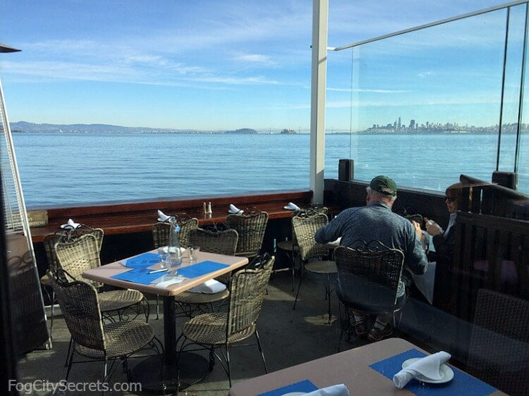 Outdoor seating at the Trident restaurant in Sausalito, view of city and bay.