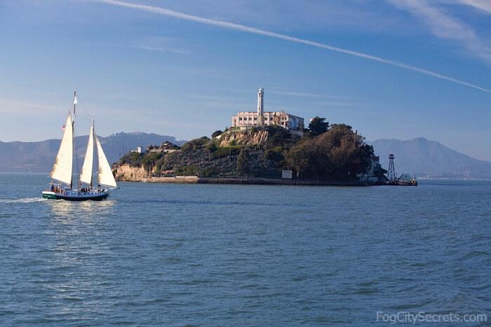 Sailboat in front of Alcatraz Island